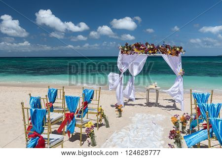 decorated wedding arch  on Puka beach at Boracay island Philippines
