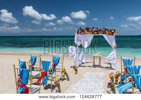 decorated wedding arch  on Puka beach at Boracay island Philippines