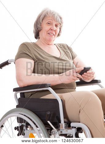 Senior woman in wheelchair using smart phone
