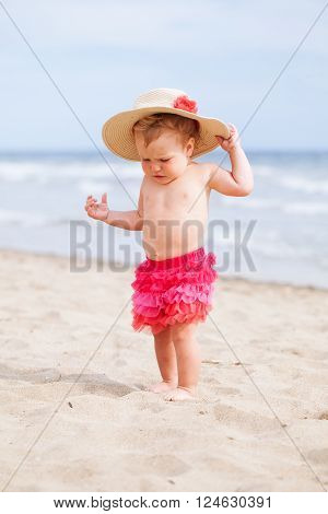Little cute happy girl bathes in sea Italy