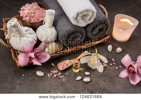 Beautiful SPA composition Towels sea salt and a burning candle