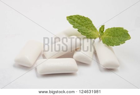 Fresh leas mint with six chewing gum isolated on white background