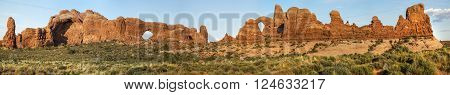 Panorama of the Windows formation featuring several arches and hoodoos in Arches National Monument near Moab Utah.