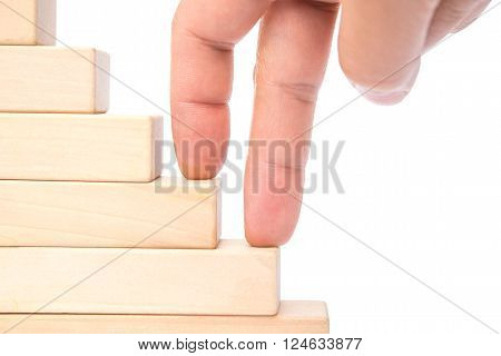 climbing up stairs made up by wooden blocks on white with clipping path