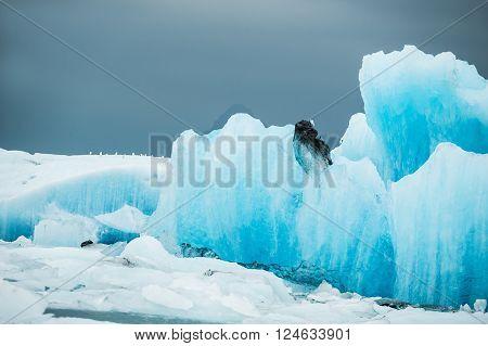 Big blue icebergs in Jokulsarlon glacial lagoon South Iceland