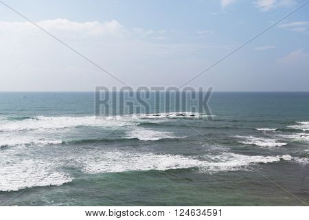 seascape, nature, travel and water concept - sea and sky on Sri Lanka