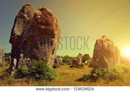 Megalithic monuments menhirs in Carnac at sunset ,Brittany ,France