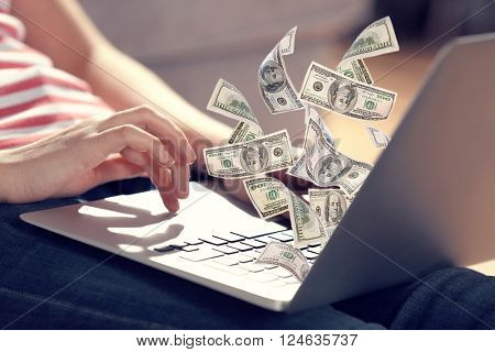 Financial concept. Make money on the Internet. Woman sitting on the floor and working with a laptop