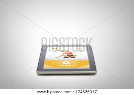 sport, training, technology, advertisement and modern gadget concept - tablet pc computer with fitness application on screen
