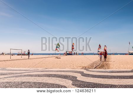 Rio de Janeiro Brazil - December 21 2012: Tourists and local people enjoying life at the beach at Copacabana Beach Rio de Janeiro.