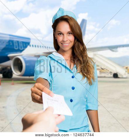 Flight hostess checking a ticket