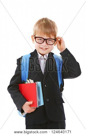 Schoolboy with backpack holding books isolated on white