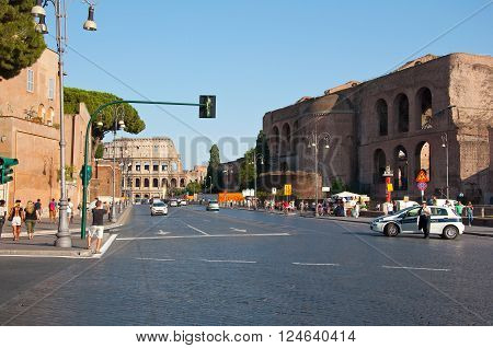 ROME-AUGUST 8: The Via dei Fori Imperiali on August 82013 in Rome Italy. The Via dei Fori Imperiali is a road in the center of the city of Rome that from the Piazza Venezia to the Colosseum.