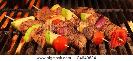 Mixed Kebabs With Meat And Vegetables On The Hot BBQ Grill