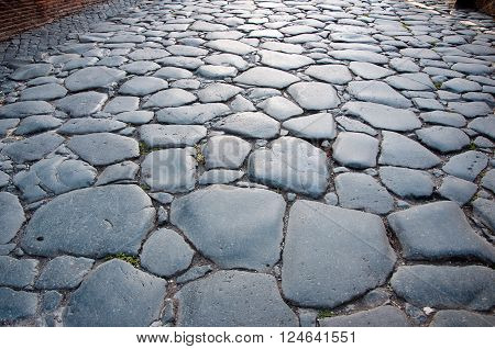 The pavement in Rome Italy in midday.
