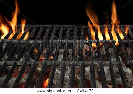Empty BBQ Flaming Charcoal Grill With Bright Flames Of Fire Isolated On The Black Background Close Up Copy Space Top View. Cookout Food Concept