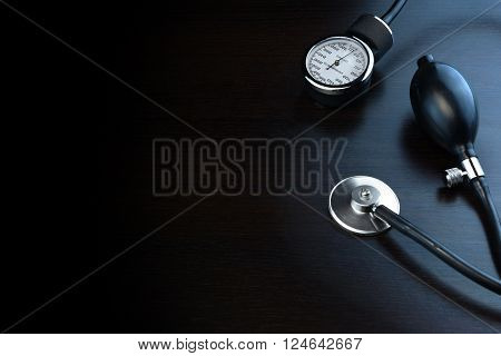 Cardiology Medical Equipment On Black Wooden Background In Back Light