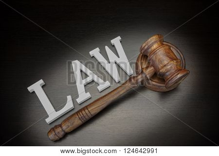 Judges Gavel And Sign Law On Wood Background, Top View