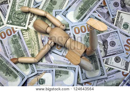 Wooden Human Figurine On The Dollar Cash Background