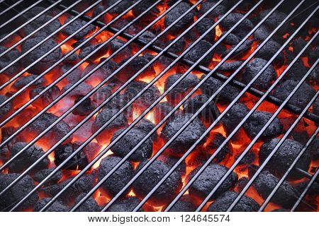 Bbq Grill And Glowing Hot Charcoal Briquettes In The Background