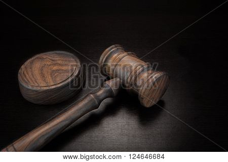 Judges Or Auctioneer Gavel On Black Wood Grunge Background Top View Close-Up.