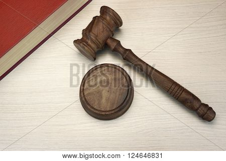 Judges Or Auctioneer Gavel And Book On White Wood  Background