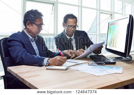 partner of senior engineering working man serious meeting about project discussing solution shot on table in office meeting room