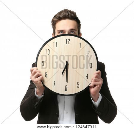 Man in black suit holding big clock on white background