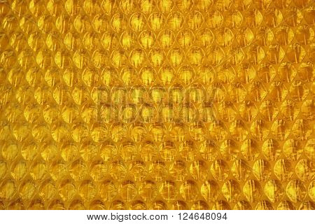 Amber Bubble Wrap Packing Or Air Cushion Film Abstract Background