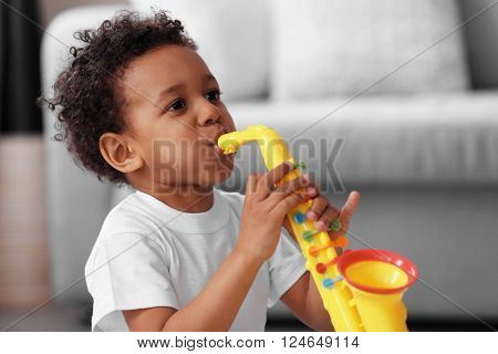 Little boy playing  with musical toy