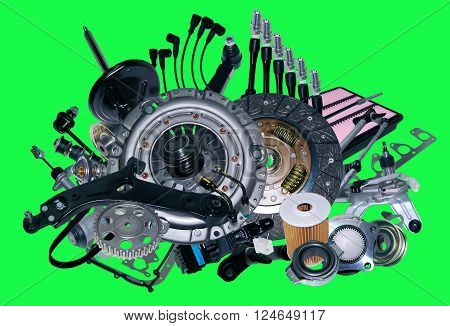 Many new spare parts for a car isolated on green screen, chroma key