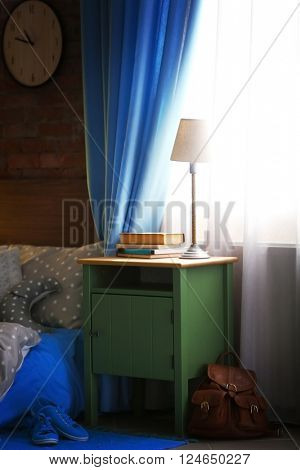 Green bedside table in living room