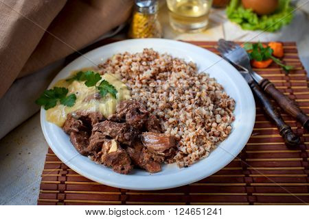 Hot gulyash, roast meat, in white souce
