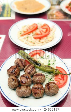 Grilled Turkish meatballs on a Plate in Restaurant.