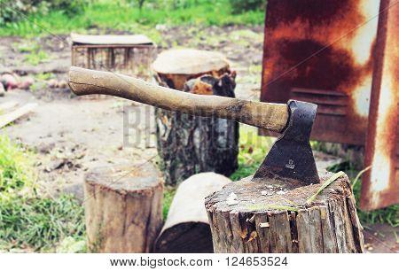 An axe on a stump in the garden