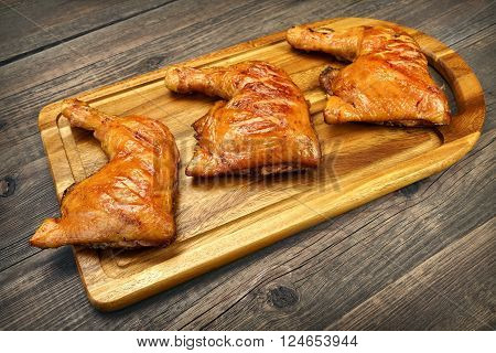 Three Grilled Bbq Chicken Leg Quarter On Wood Board