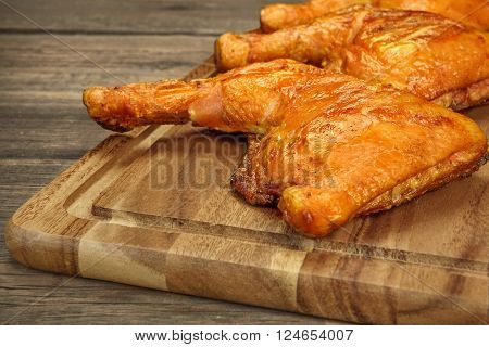 Three Grilled BBQ Crispy Chicken Leg Quarter On The Wood Board And Country Table In The Background Top View Closeup