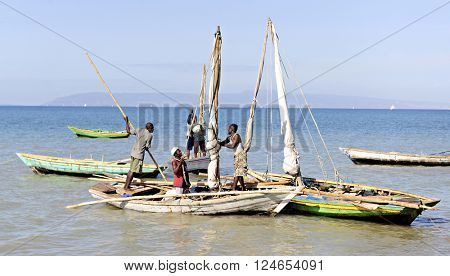 SAINTARD, HAITI - MARCH 2, 2016:  Unidentified Haitian fishing men in their boats preparing for a day of fishing off the shore near Saintard, Haiti on March 2, 2016.
