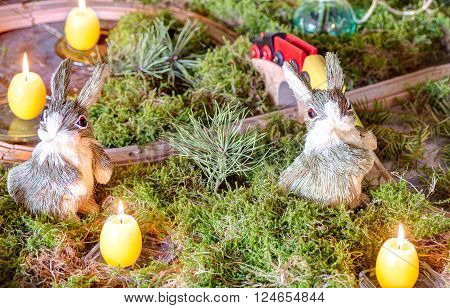 Easter decoration with candles bunny and moss