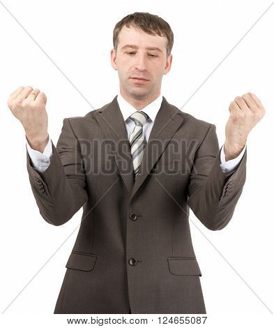 Businessman raised his hands up in front of him. Isolated on white background