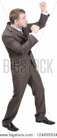 Businessman standing in fighting stock raising their fists up. Side view