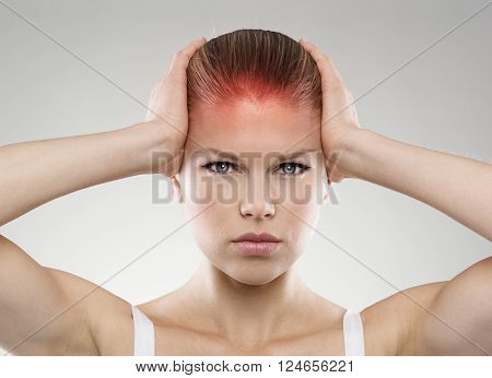 Head pain or injury. Young stressed female suffering from dizziness or tension. Medical treatment and health care concept.