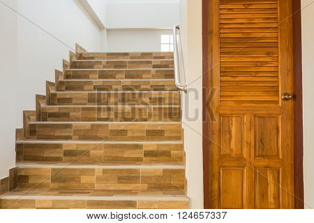 staircase in residential house with stainless steel banister