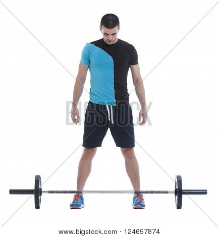 Fitness trainer doing an exercise with olympic barbell. Image isolated on white background.