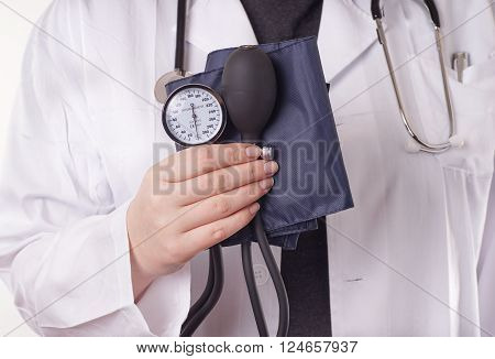 Doctor standing with blood pressure gauge sphygmomanometer in the hand ready for the medical check up