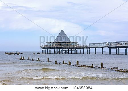 Heringsdorf Usedom Germany - June 27 2012: Famous pier with restaurant building at its end. A tourist hotspot at the beach / baltic sea.