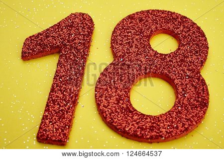 Number eighteen red color over a yellow background. Anniversary. Horizontal
