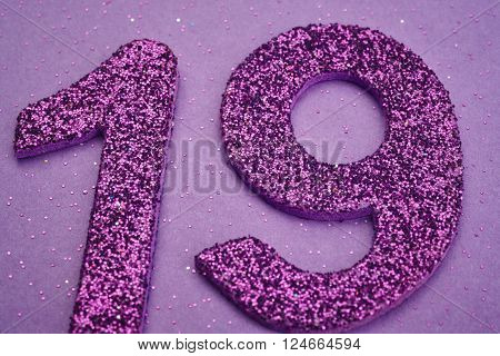 Number nineteen purple color over a purple background. Anniversary. Horizontal