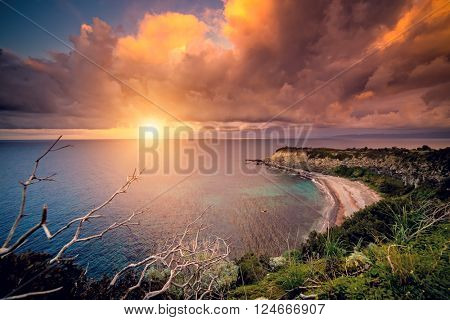 Fantastic view of the overcast sky. Dramatic morning scene. Location: cape Milazzo, nature reserve Piscina di Venere. Island Sicilia, Italy, Europe. Mediterranean and Tyrrhenian sea. Beauty world.