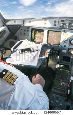 Pilot in the cockpit during a commercial flight